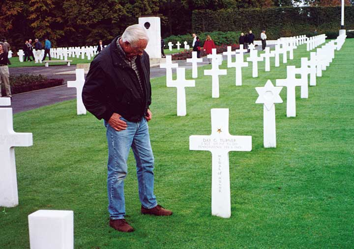 Man at Normandy Beach American cemetery