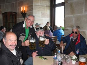 historian and guests drinking beer on Band of Brother stour