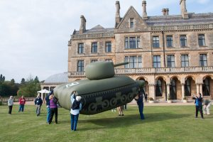 Ghost Army tour guests with inflatable tank